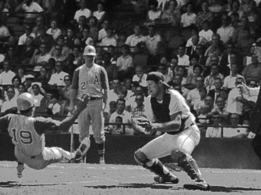 Tigers catcher Bill Freehan gets ready to apply the tag at the plate during a game against the Oakland Athletics in 1967.
