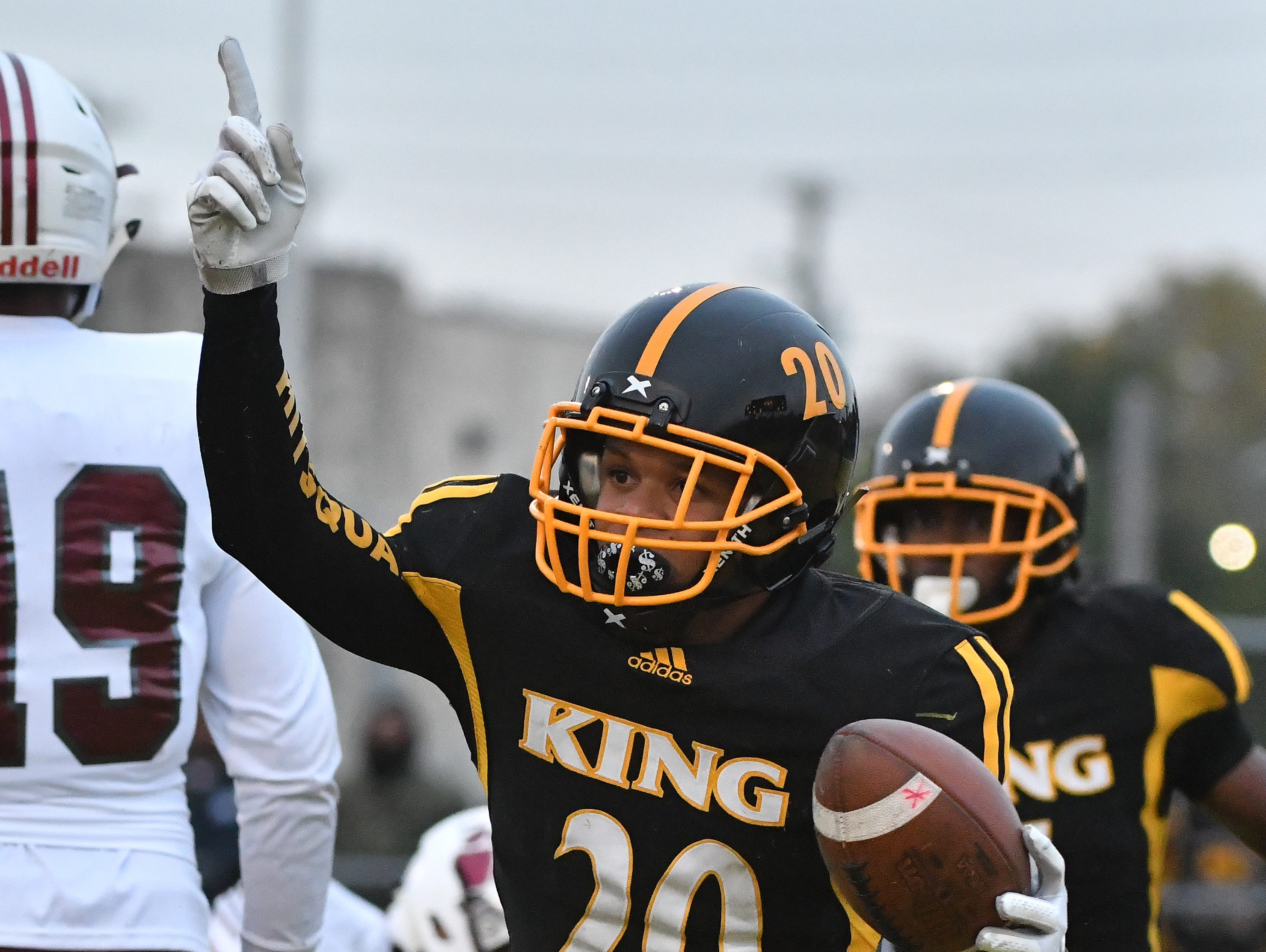 King's Jaylen Reed celebrates after recovering a fumble by River Rouge quarterback Emmanuel Ferguson in the endzone in the second quarter.