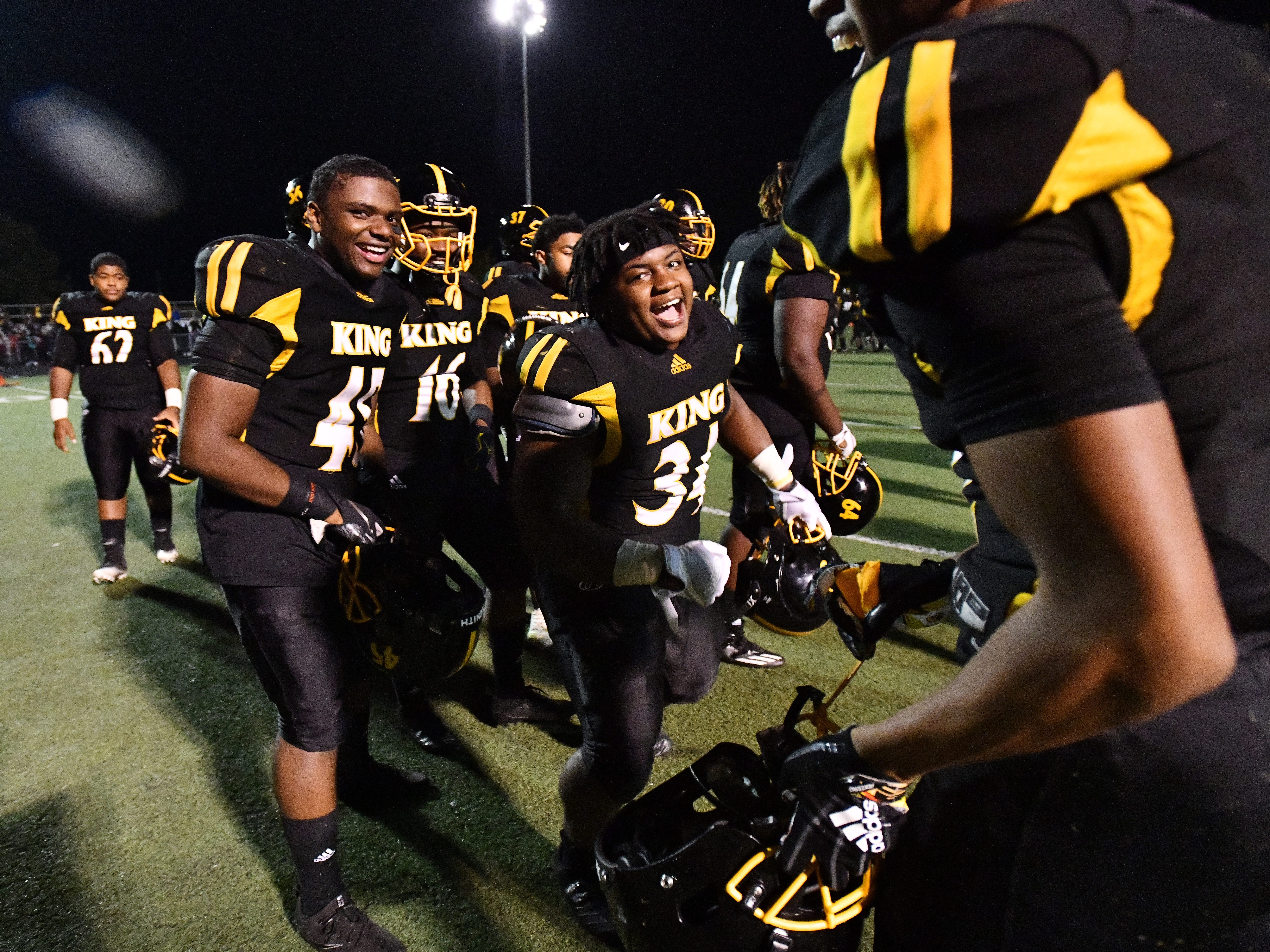 A celebratory dance by King's Lorenzo White Jr. and teammates after Martin Luther King Jr. Senior High School beat River Rouge 7-6 in a playoff game in Detroit, Michigan on October 26, 2018.