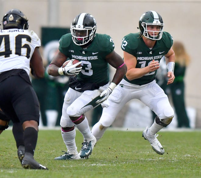 Michigan State running back LJ Scott could possibly redshirt.