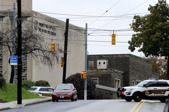 Police respond to an active shooter situation at the Tree of Life synagogue on Wildins Avenue in the Squirrel Hill neighborhood of Pittsburgh, Pa., on Saturday.