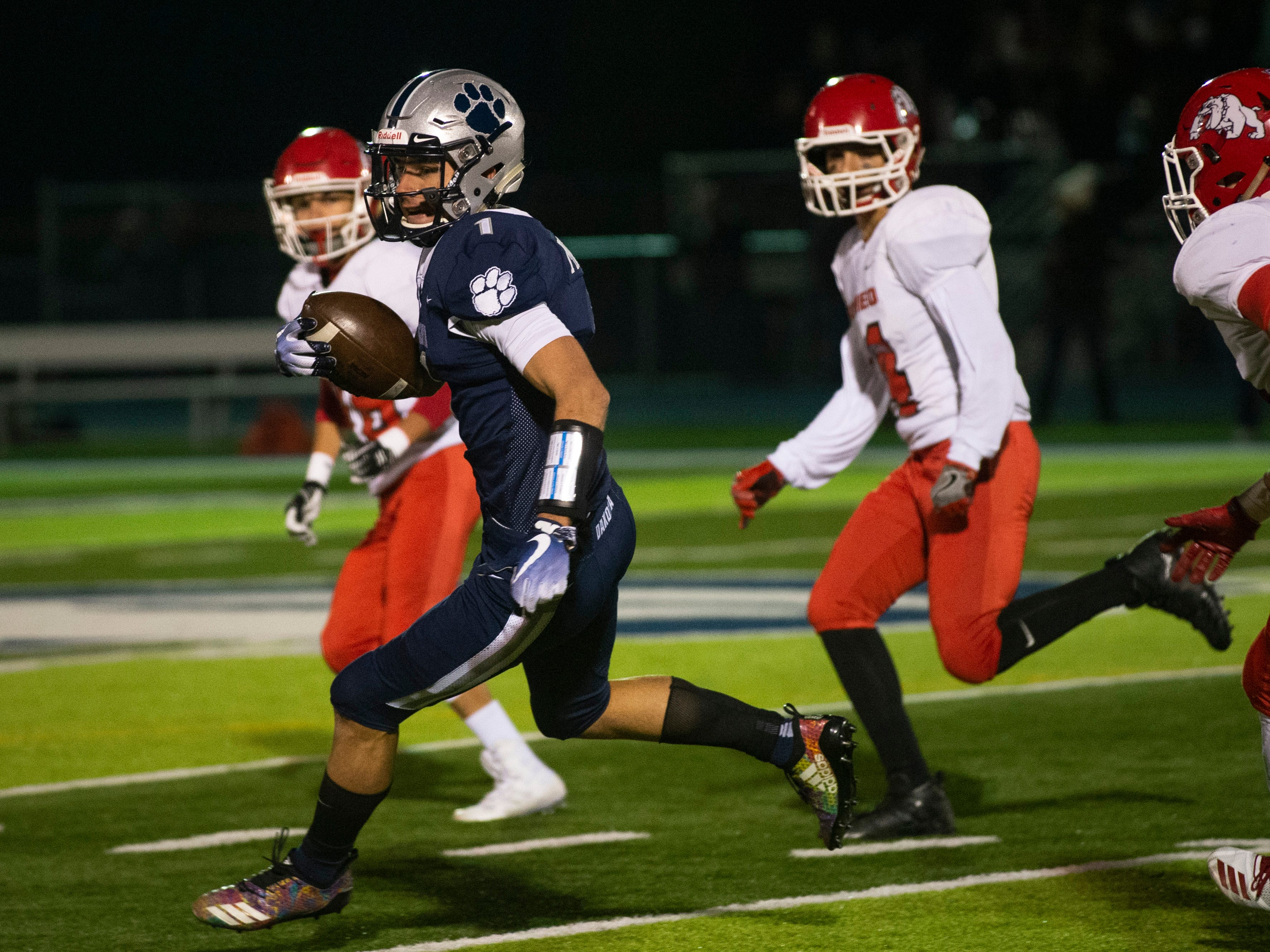 Dakota's Brandon Michalak moves with the ball during the 2nd quarter.