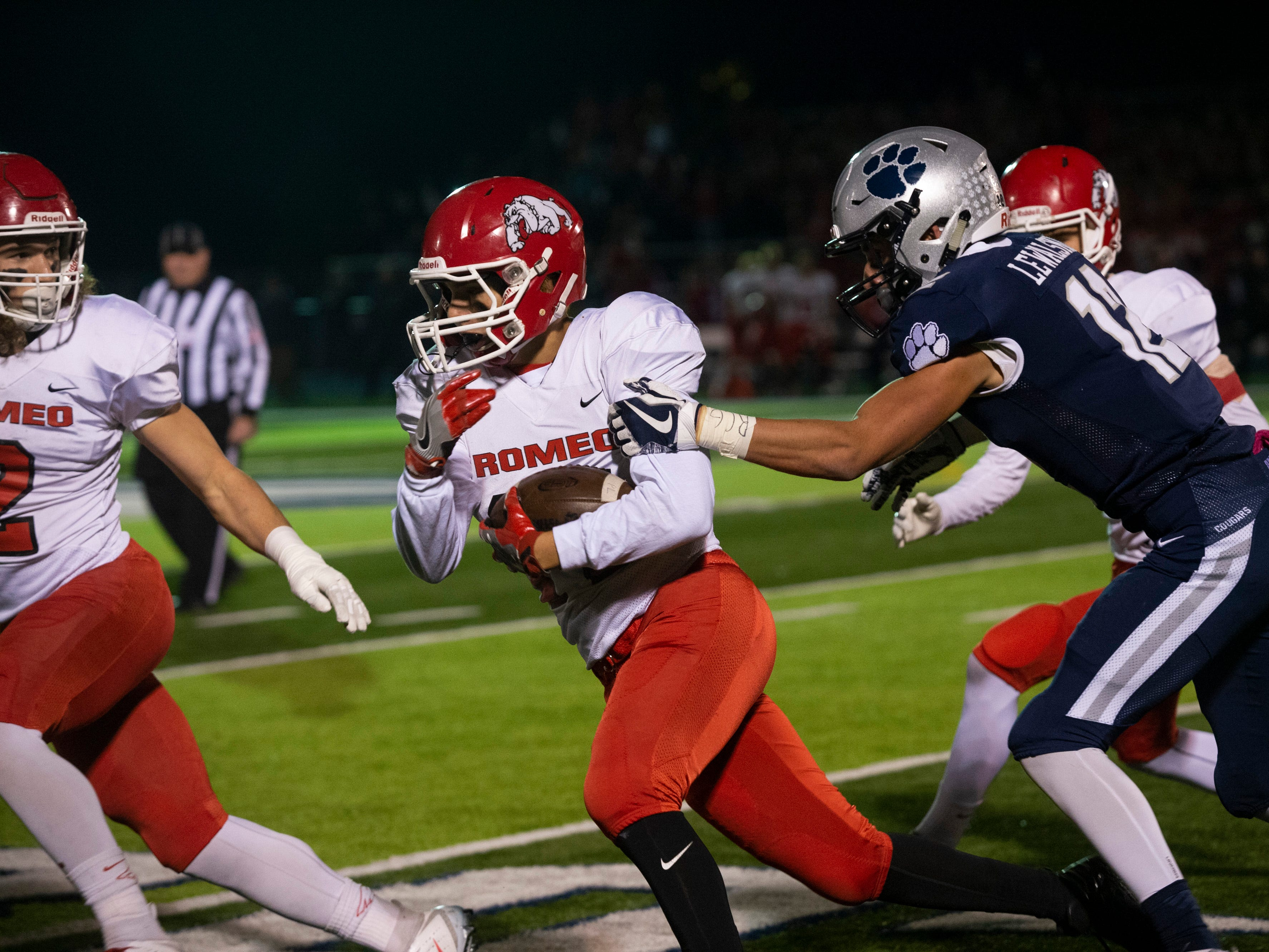 Romeo's Logan Iafrate moves with the ball as he is chased by Dakota's Ross Lewalski during the 1st quarter.