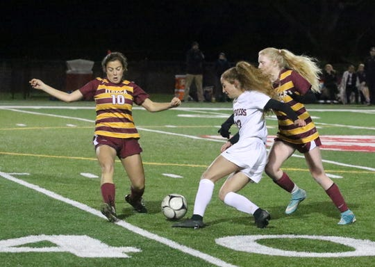 Parker Moss of Elmira goes up the field as Ithaca's Ella Goodman (10) steps in the way during the Section 4 Class AA girls soccer championship game Oct. 26, 2018 at Waverly Memorial Stadium.