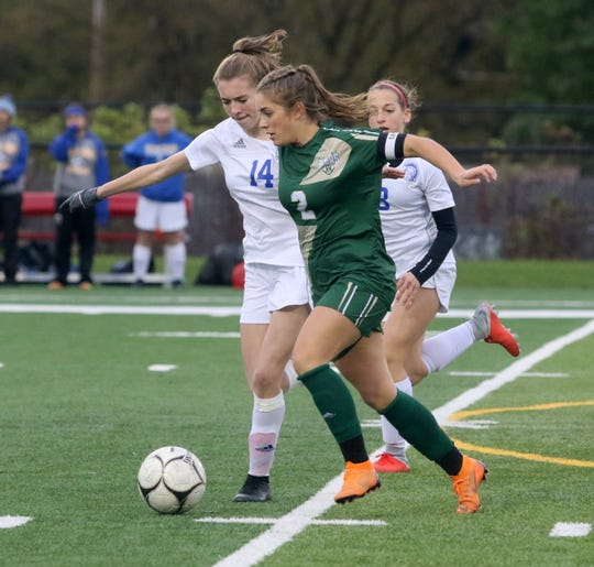 Olivia McKnight of Vestal takes the ball up the field as Maine-Endwell's Rylee Alston, left, and Emily Blight defend during the Section 4 Class A girls soccer final Oct. 26, 2018 at Waverly Memorial Stadium.
