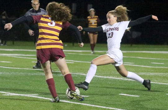 Parker Moss (13) of Elmira and Alecia Nicholas (3) of Ithaca go for the ball during the Section 4 Class AA girls soccer final Oct. 26, 2018 at Waverly Memorial Stadium.