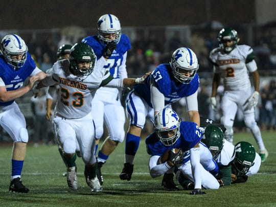 Vincennes Lincoln defenders bring down a Memorial running back in the Class 3A sectional semifinal at Enlow Field. The Alices would be affected by a possible Big Eight-Pocket merger.