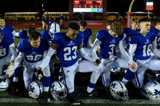 The Memorial Tigers pray inside the home end zone after defeating the Vincennes Lincoln Alices in the IHSAA Class 3A Sectional 32 semi-final at Enlow Field in Evansville, Ind., Friday, Oct. 26, 2018. The Tigers defeated the Alices, 52-6.