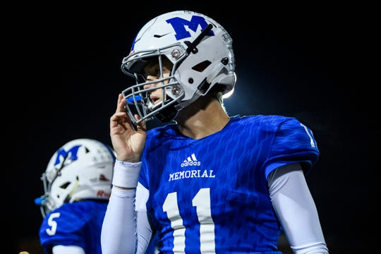 Memorial's Michael Lindauer (11) during a timeout in the second quarter against the Vincennes Lincoln Alices in the IHSAA Class 3A Sectional 32 semi-final match up at Enlow Field in Evansville, Ind., Friday, Oct. 26, 2018.