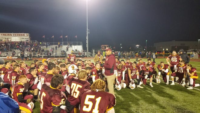 Gibson Southern football head coach Nick Hart addresses his team after a 24-14 win over Heritage Hills on Friday night.