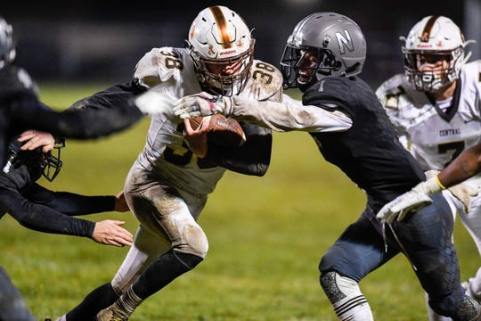 Central's Brennan Schutte (38) runs against defense from Northview's Trevor Cook (1) as the Evansville Central Bears play the Northview Knights in the Class 4A sectional semifinal at Brazil, In. Friday, October 26, 2018.