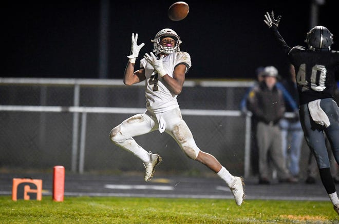 Central's Malcolm Depriest (4) makes a touchdown catch as the Evansville Central Bears play the Northview Knights in the Class 4A sectional semifinal at Brazil, In. Friday, October 26, 2018.