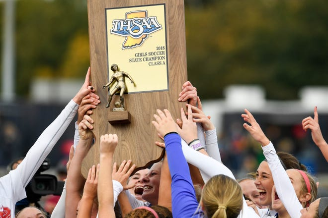 The Wildcats are presented with their Class 1A State Championship trophy as the defending state champions Mater Dei Wildcats play the Wheeler Bearcats in the Class 1A state championship game in Indianapolis Saturday, October 27, 2018.