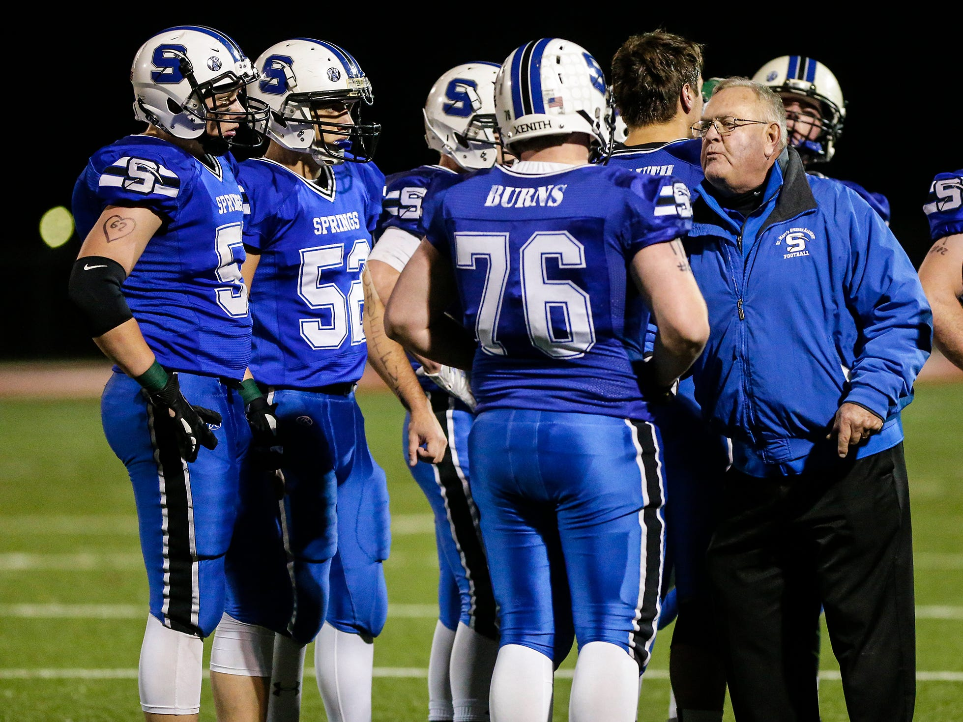 St. Mary's Springs Academy football head coach Bob Hyland talks with his players during a time out during their WIAA division five, level 2 playoff game against Omro High School Friday, October 26, 2018 played in Lomira, Wisconsin. Springs won the match-up 33-20. Doug Raflik/USA TODAY NETWORK-Wisconsin