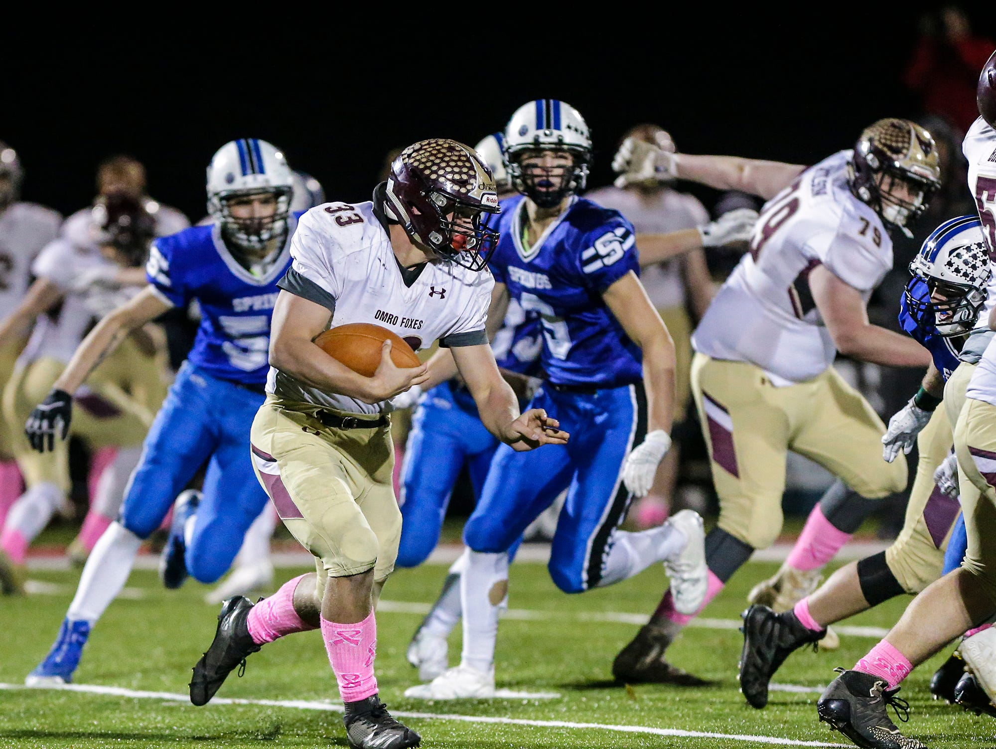 Omro High School football's Jaeden Frost runs the ball against St. Mary's Springs Academy Friday, October 26, 2018 during their WIAA division five, level 2 playoff game played in Lomira, Wisconsin. Springs won the match-up 33-20. Doug Raflik/USA TODAY NETWORK-Wisconsin