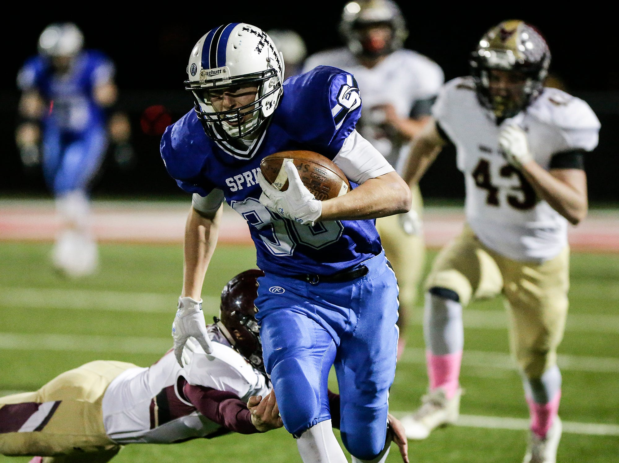 St. Mary's Springs Academy football's Ezra Tucker breaks a tackle from Omro High School's Ben Wellhoefer Friday, October 26, 2018 during their WIAA division five, level 2 playoff game played in Lomira, Wisconsin. Springs won the match-up 33-20. Doug Raflik/USA TODAY NETWORK-Wisconsin