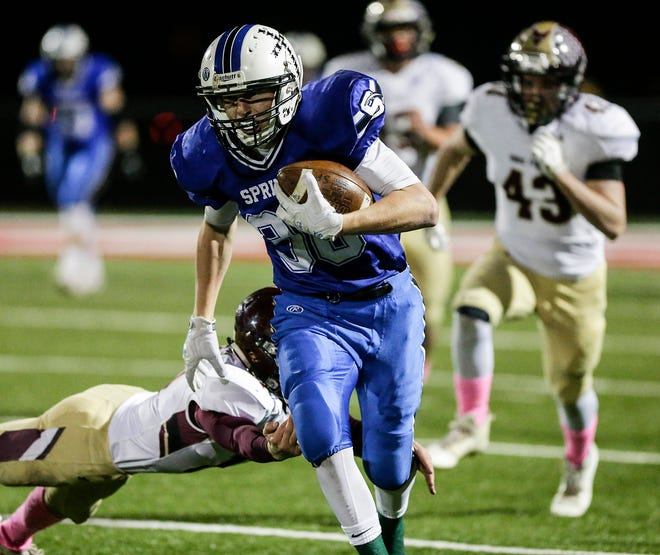 St. Mary's Springs Academy's Ezra Tucker breaks a tackle from Omro's Ben Wellhoefer on Friday in a WIAA Division 5 second-round playoff game.