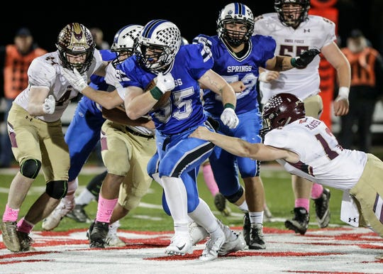 St. Mary's Springs' Marcus Orlandoni breaks a tackle from Omro's Jacob Kafer on Friday during a WIAA Division 5 seond-round playoff game in Lomira.