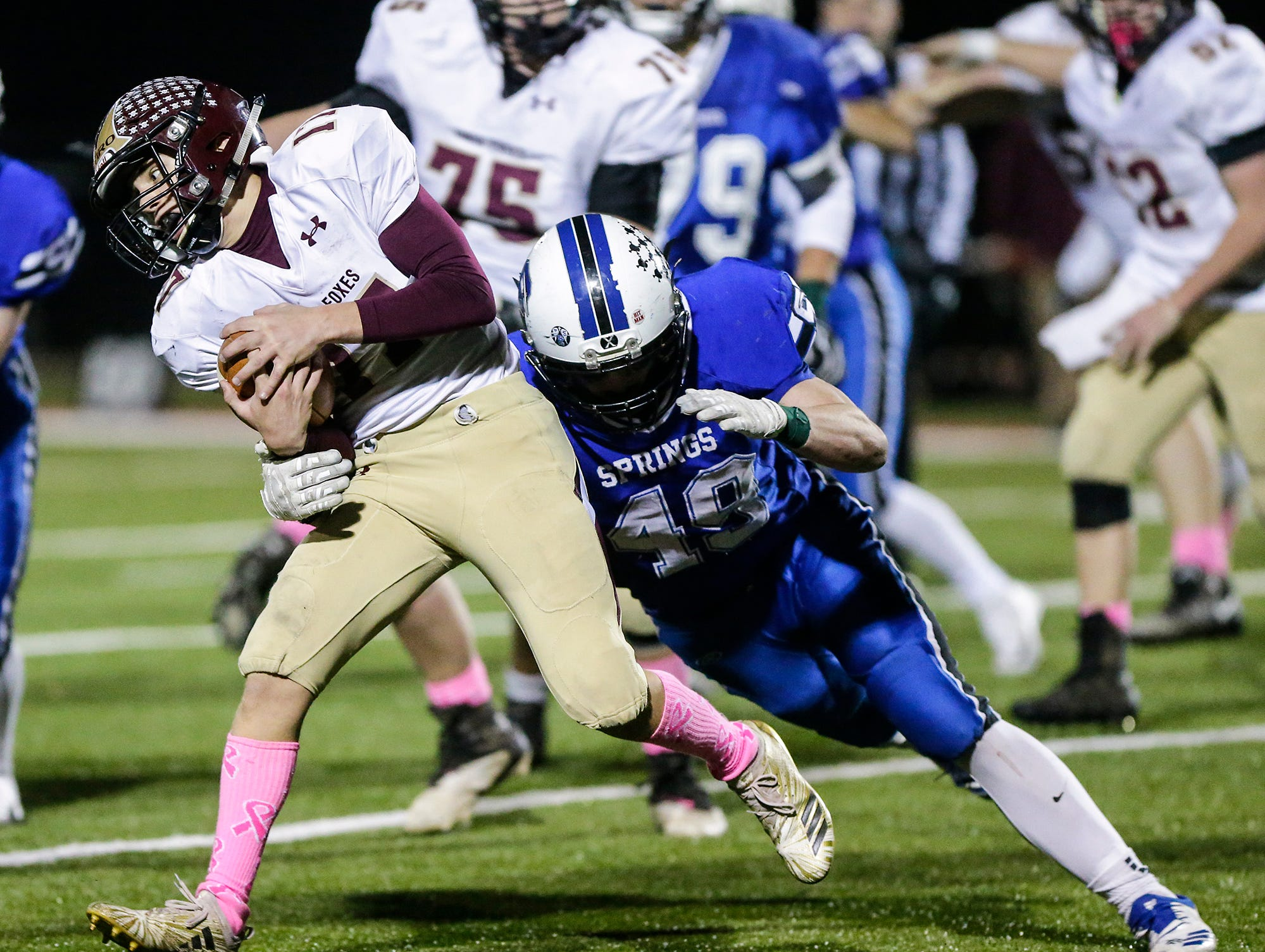 St. Mary's Springs Academy football's Jake Hoch tackles Omro High School's Ben Wellhoefer Friday, October 26, 2018 during their WIAA division five, level 2 playoff game played in Lomira, Wisconsin. Springs won the match-up 33-20. Doug Raflik/USA TODAY NETWORK-Wisconsin