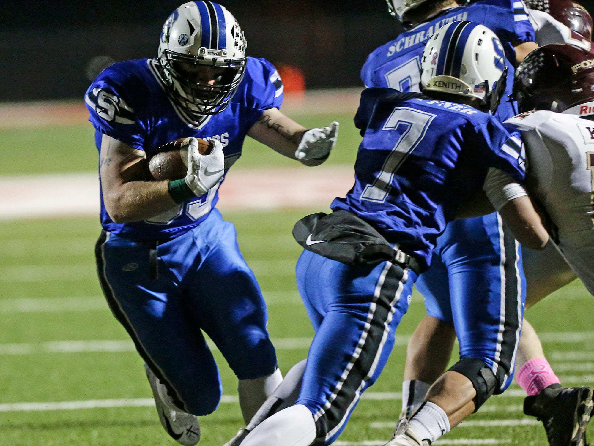 St. Mary's Springs Academy football's Marcus Orlandoni runs 10 yards to score the first touchdown of the game against Omro High School Friday, October 26, 2018 during their WIAA division five, level 2 playoff game played in Lomira, Wisconsin. Springs won the match-up 33-20. Doug Raflik/USA TODAY NETWORK-Wisconsin