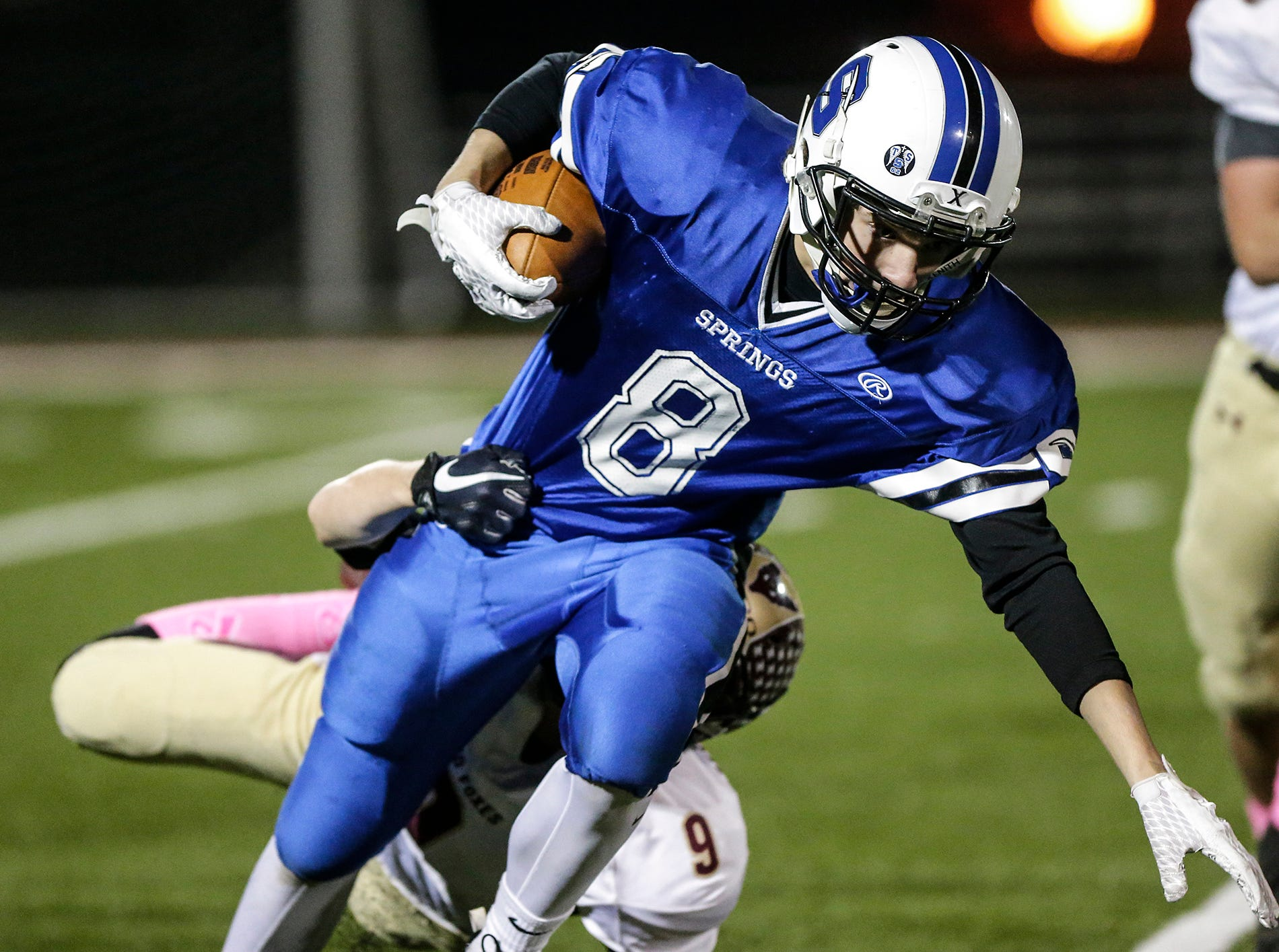 St. Mary's Springs Academy football's David Mueller gets tackled by Omro High School's Cooper Krockstrom Friday, October 26, 2018 during their WIAA division five, level 2 playoff game played in Lomira, Wisconsin. Springs won the match-up 33-20. Doug Raflik/USA TODAY NETWORK-Wisconsin
