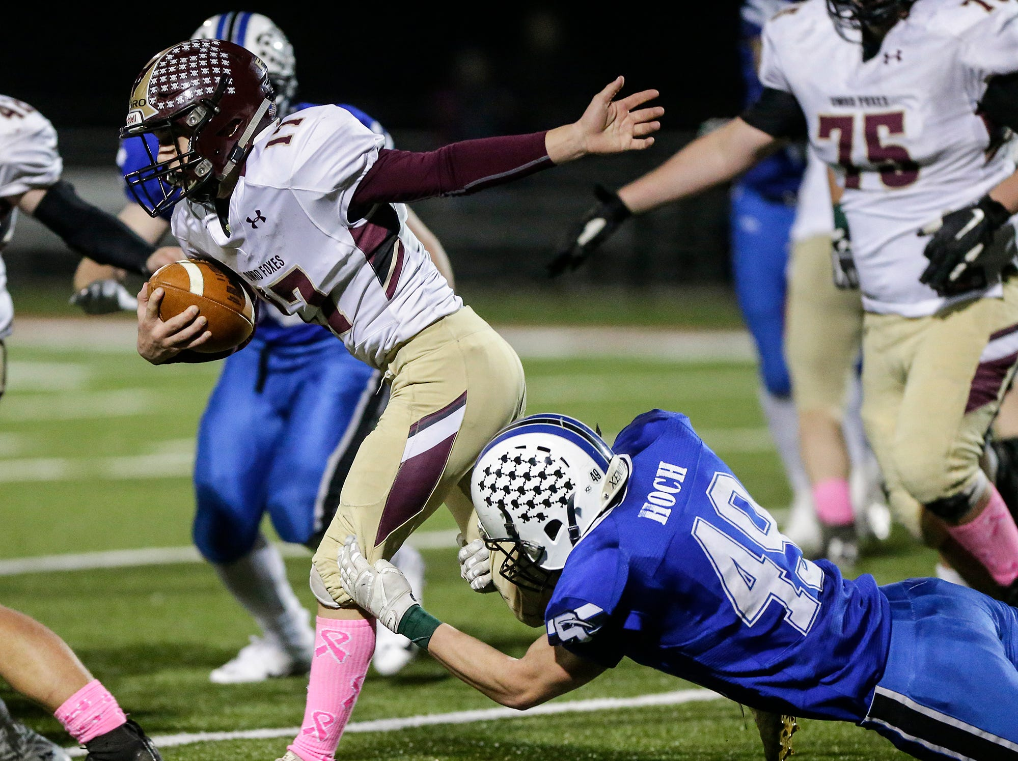 St. Mary's Springs Academy football's Jake Hoch attempts to tackle Omro High School's Ben Wellhoefer Friday, October 26, 2018 during their WIAA division five, level 2 playoff game played in Lomira, Wisconsin. Springs won the match-up 33-20. Doug Raflik/USA TODAY NETWORK-Wisconsin