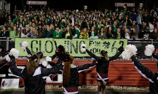 "The theme for the Fond du Lac High School football game was ""Glowing For You #62"" in honor of St. Mary's Springs junior Trent Schueffner, who died in a hunting accident a week ago. More than $4,000 was raised for the family at Fruth Field."
