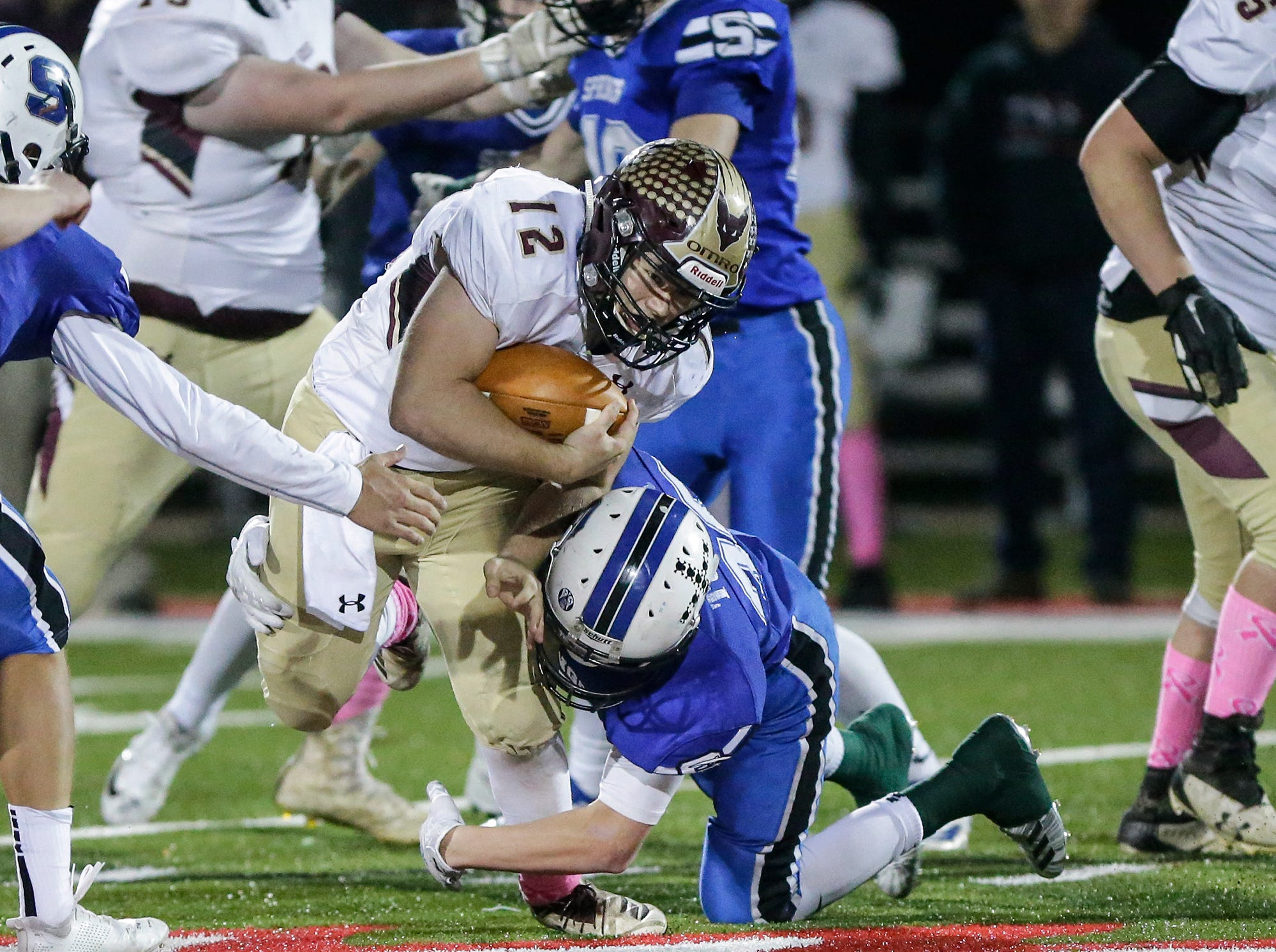 St. Mary's Springs Academy football's Ezra Tucker tackles Omro High School's Jacob Kafer Friday, October 26, 2018 during their WIAA division five, level 2 playoff game played in Lomira, Wisconsin. Springs won the match-up 33-20. Doug Raflik/USA TODAY NETWORK-Wisconsin