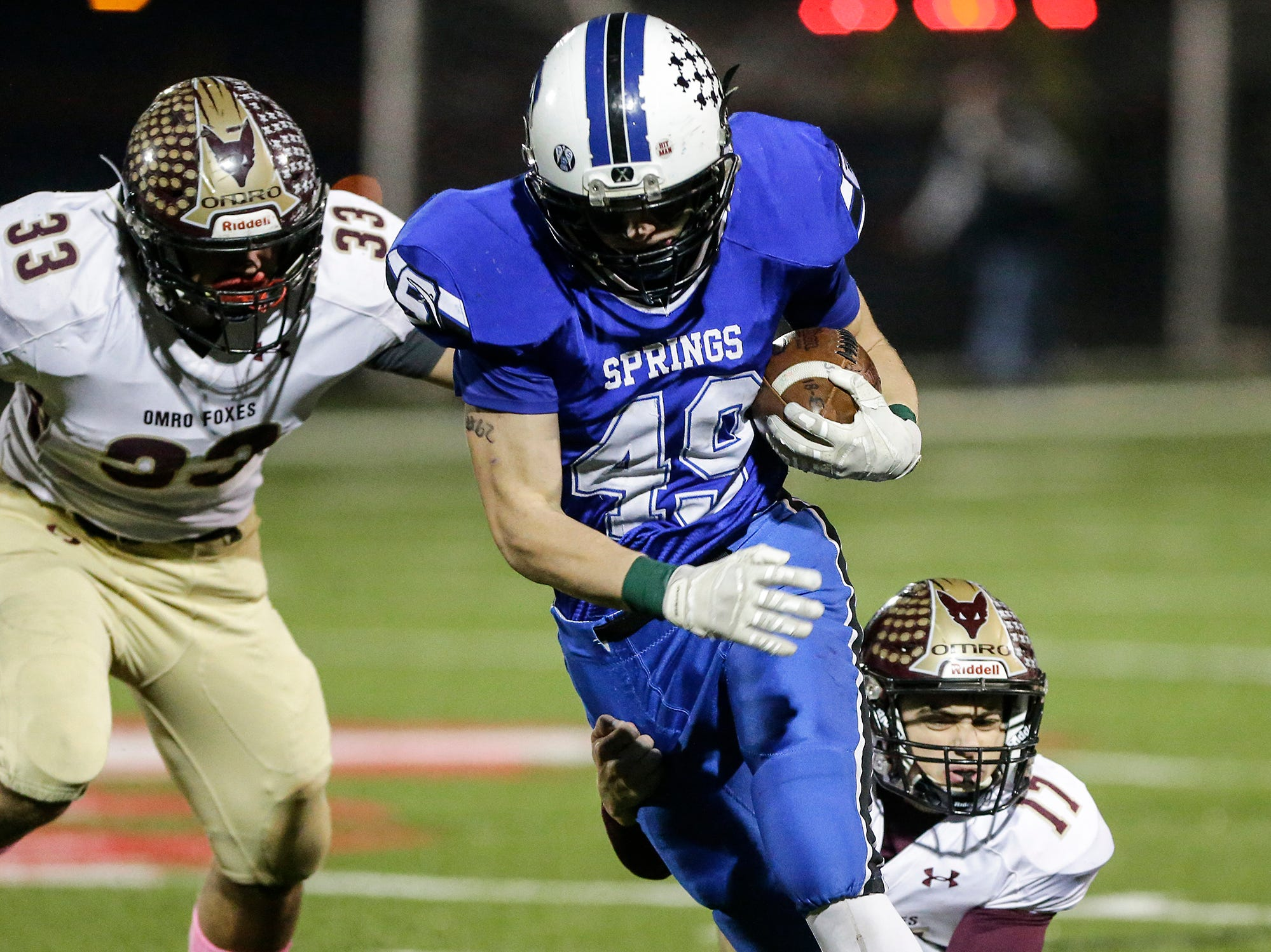 St. Mary's Springs Academy football's Jake Hoch breaks a tackle from Omro High School's Ben Wellhoefer Friday, October 26, 2018 during their WIAA division five, level 2 playoff game played in Lomira, Wisconsin. Springs won the match-up 33-20. Doug Raflik/USA TODAY NETWORK-Wisconsin