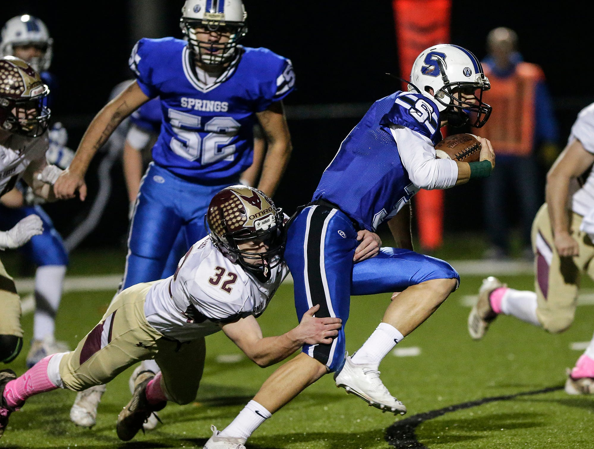 St. Mary's Springs Academy football's Mitchell Waechter breaks this tackle from Omro High School's Thomas Soda-Waters Friday, October 26, 2018 during their WIAA division five, level 2 playoff game played in Lomira, Wisconsin. Springs won the match-up 33-20. Doug Raflik/USA TODAY NETWORK-Wisconsin