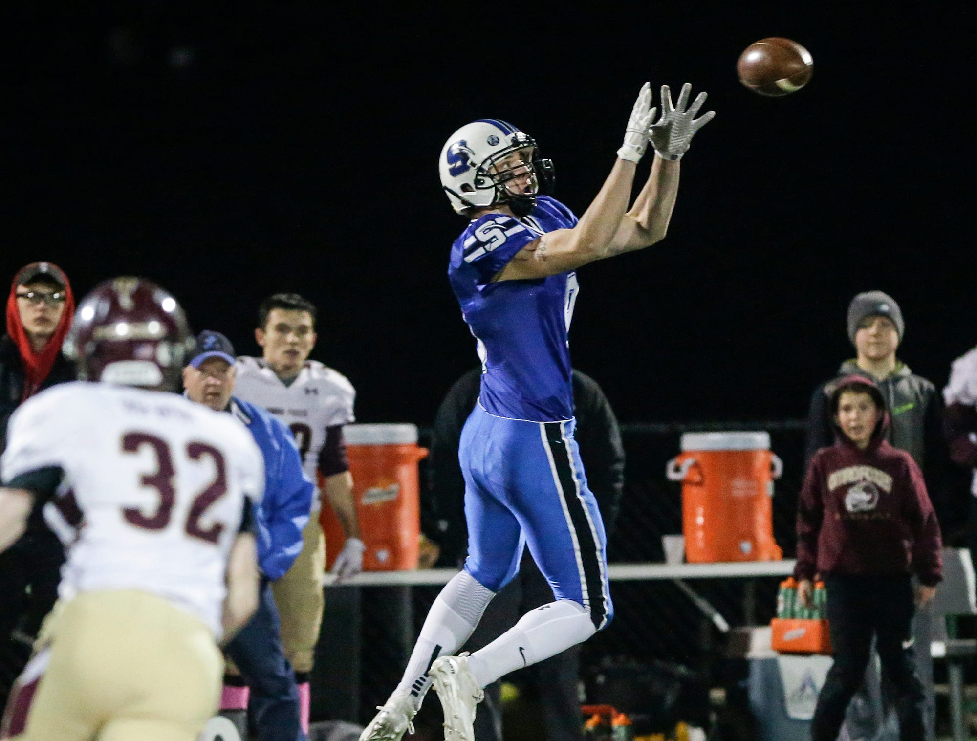 St. Mary's Springs Academy football's Cade Christensen catches this ball for a six yard gain gainst Omro High School Friday, October 26, 2018 during their WIAA division five, level 2 playoff game played in Lomira, Wisconsin. Springs won the match-up 33-20. Doug Raflik/USA TODAY NETWORK-Wisconsin