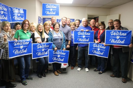 Jon Husted, Republican candidate for lieutenant governor as running mate to Mike DeWne, takes a photo with supporters and other Republican candidates at Sandusky County's GOP headquarters in Fremont on Saturday.