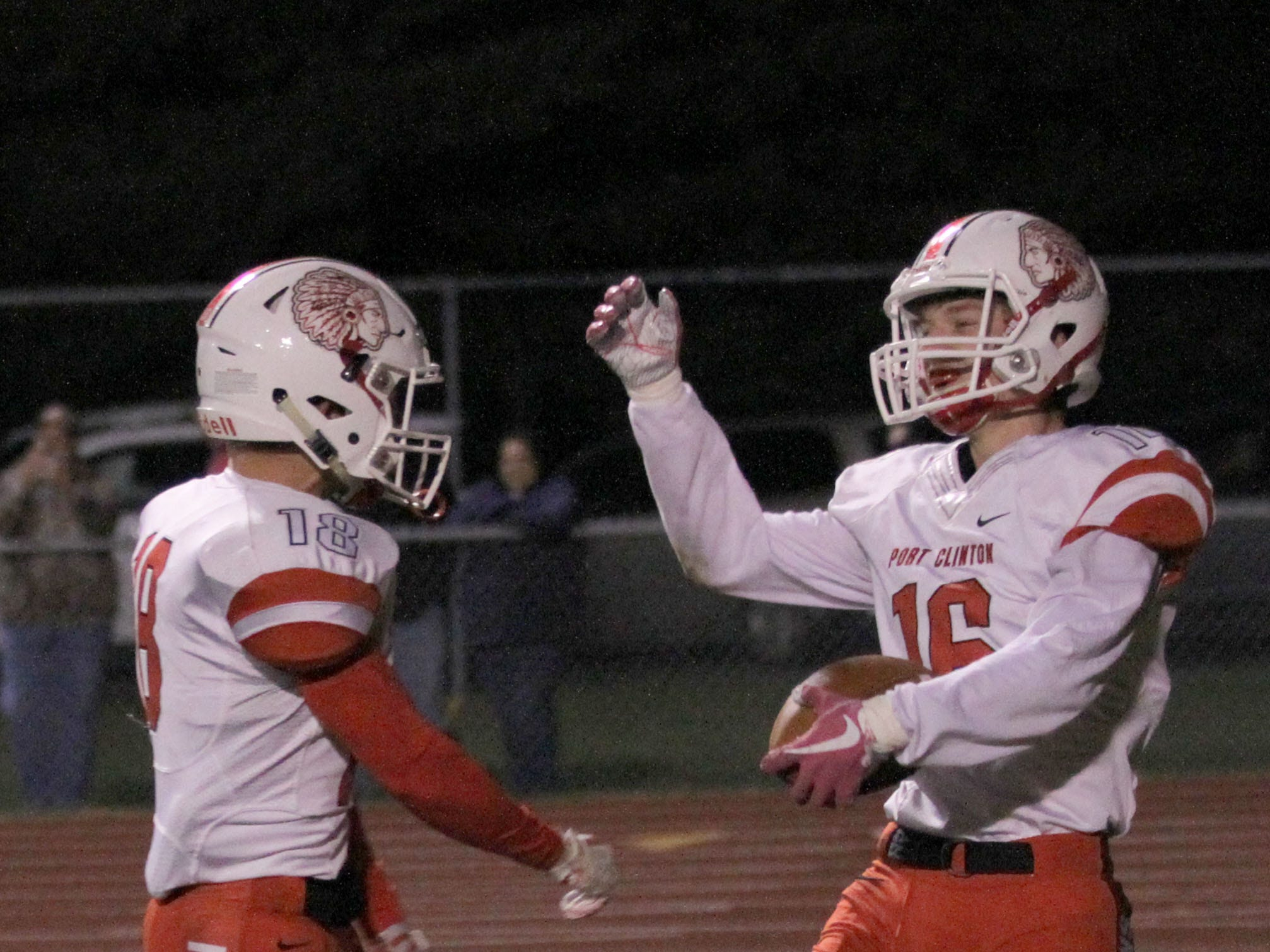 Port Clinton's Caden Swander and Nikolas Skoufos celebrate a touchdown against Oak Harbor.