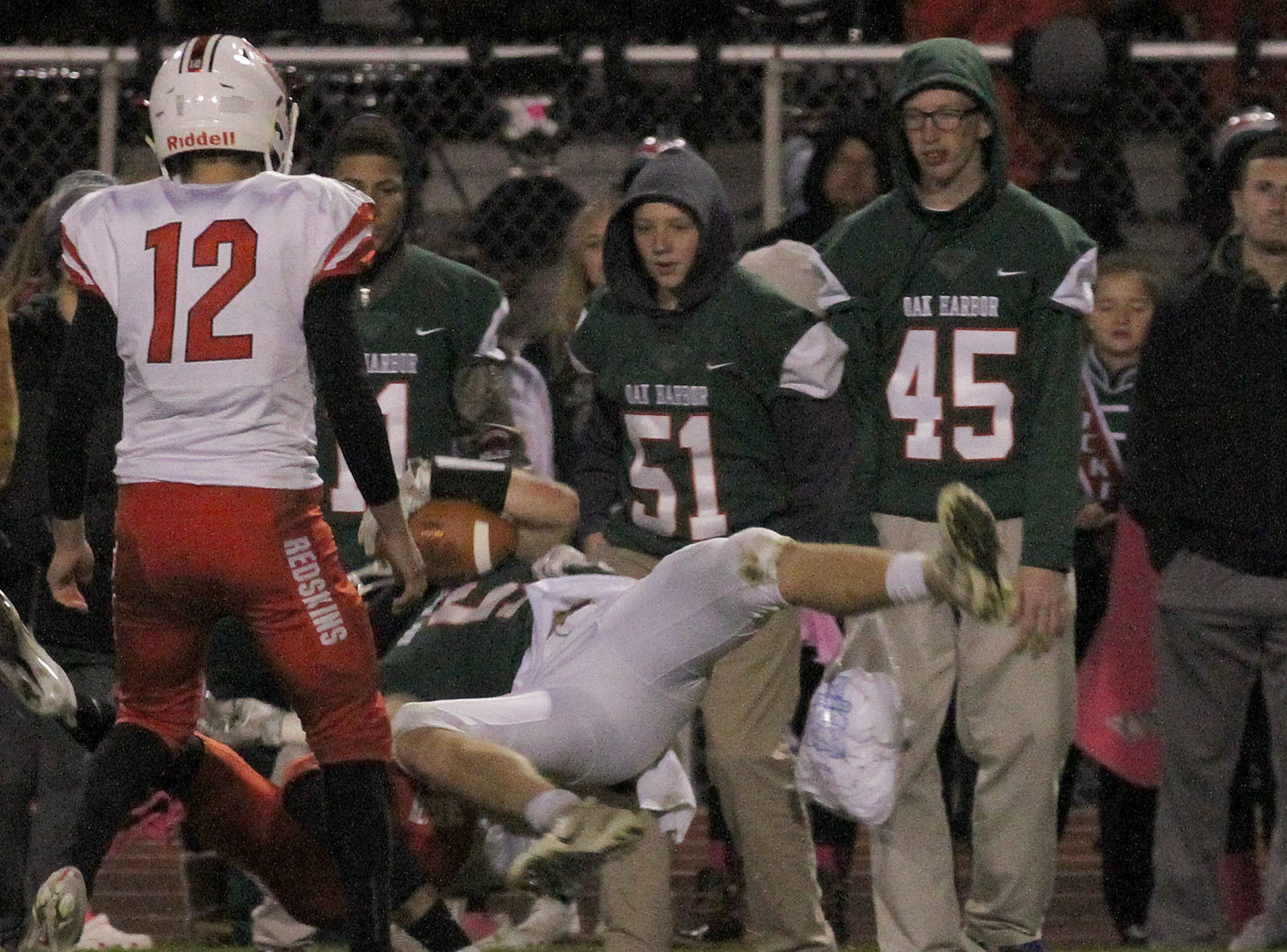 Oak Harbor's Clay Schulte is upended by a Port Clinton defender.