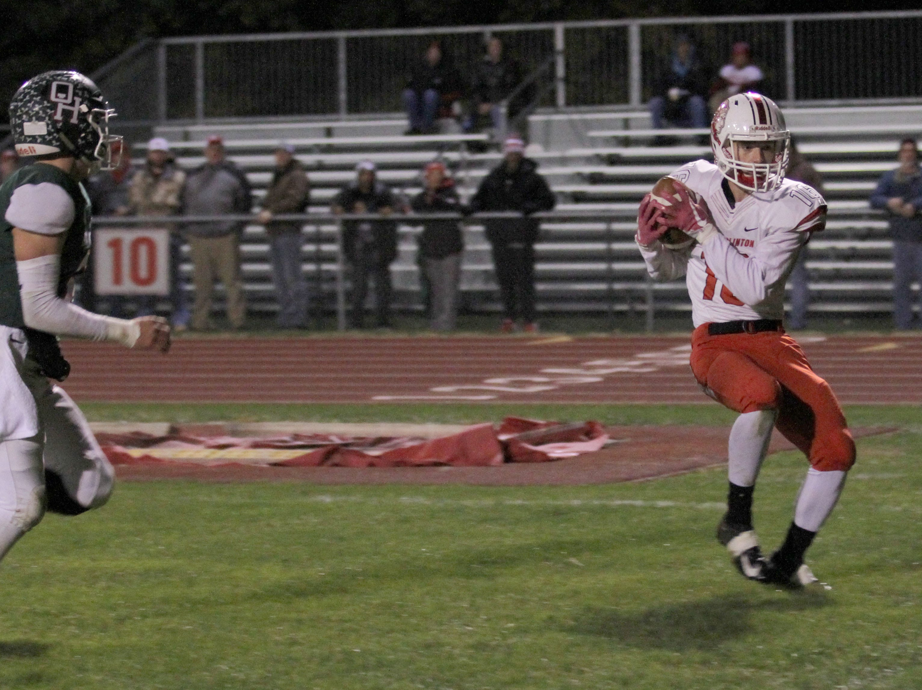 Port Clinton's Nikolas Skoufos hauls in the pass for a touchdown against Oak Harbor.