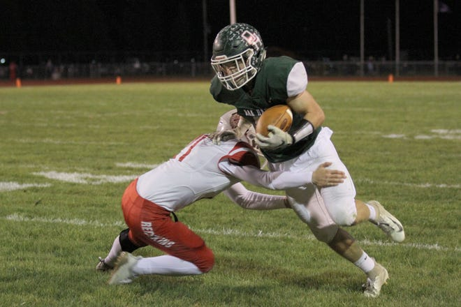 Port Clinton's Westin Laird makes a tackle against Oak Harbor.