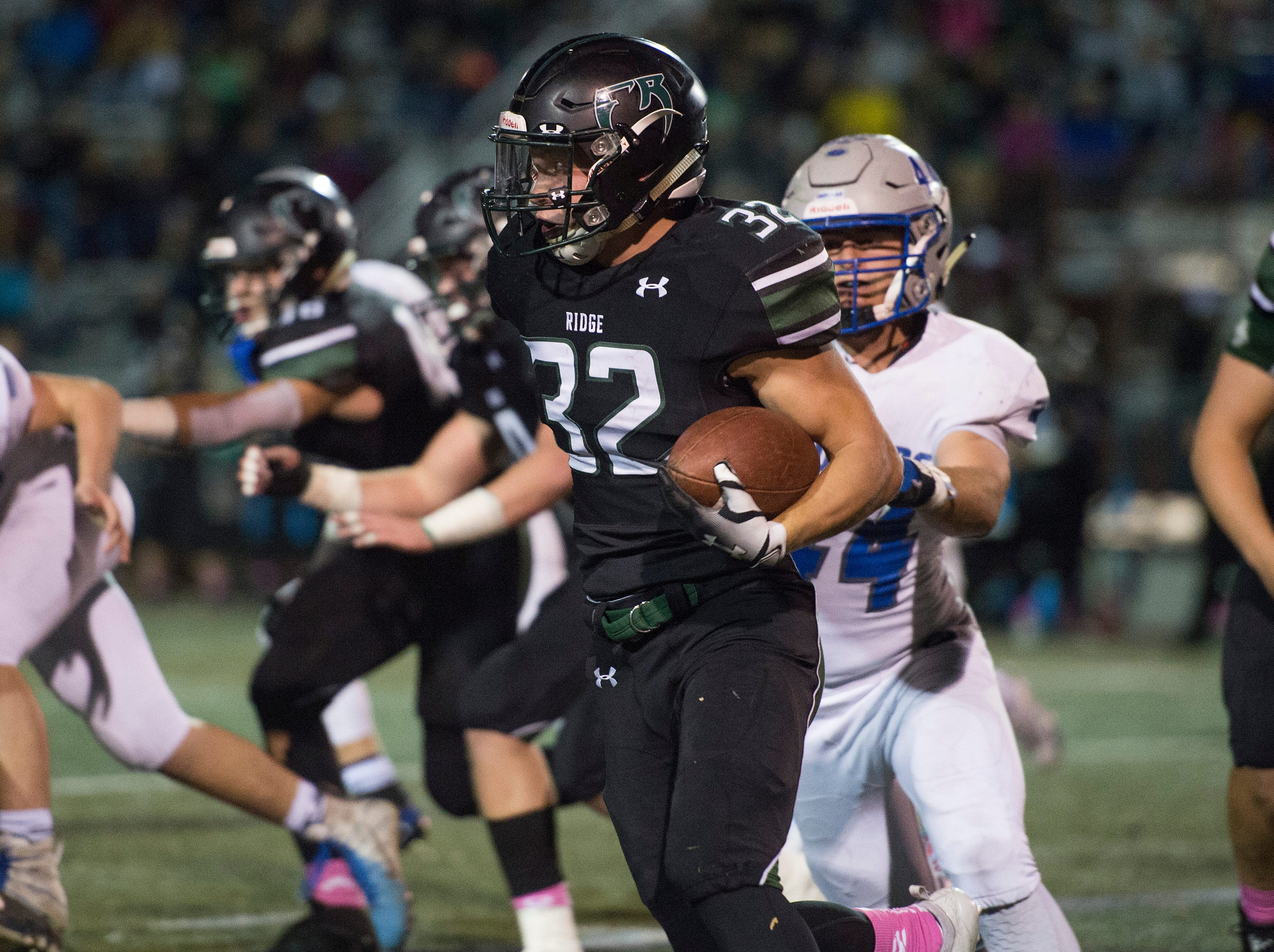 Fossil Ridge's Casey Knutsen breaks away from Impalas defense as he runs the ball in a game against Poudre at French Field on Friday, October 26, 2018.