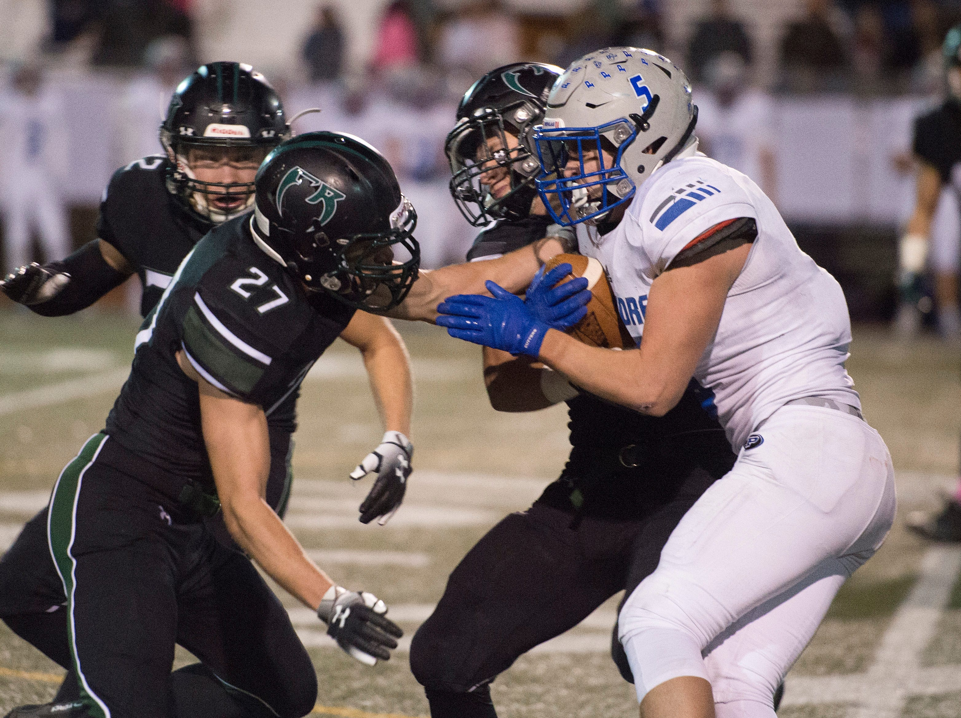 Poudre High School's Triston Burkett tries to get around Fossil Ridge defense during a game at French Field on Friday, October 26, 2018.