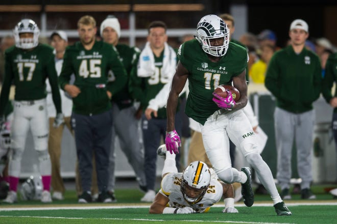 Colorado State University junior wide receiver Preston Williams (11) turns upfield after a reception against University of Wyoming defenders on Friday, Oct. 26, 2018, at Canvas Stadium in Fort Collins, Colo.