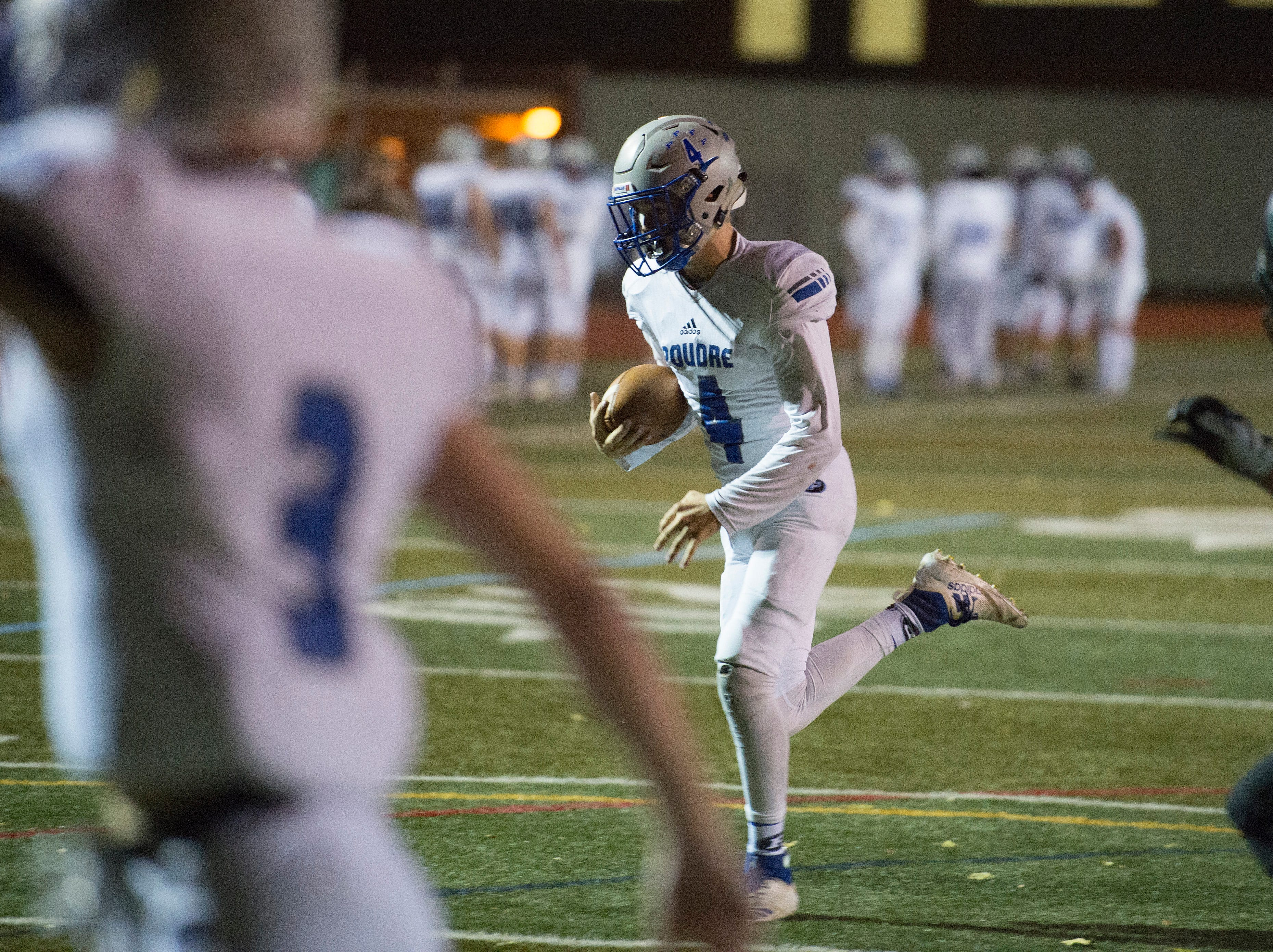 Poudre's Nate Wood runs the ball into the end zone for a 2-point conversion during a game against Fossil Ridge at French Field on Friday, October 26, 2018.
