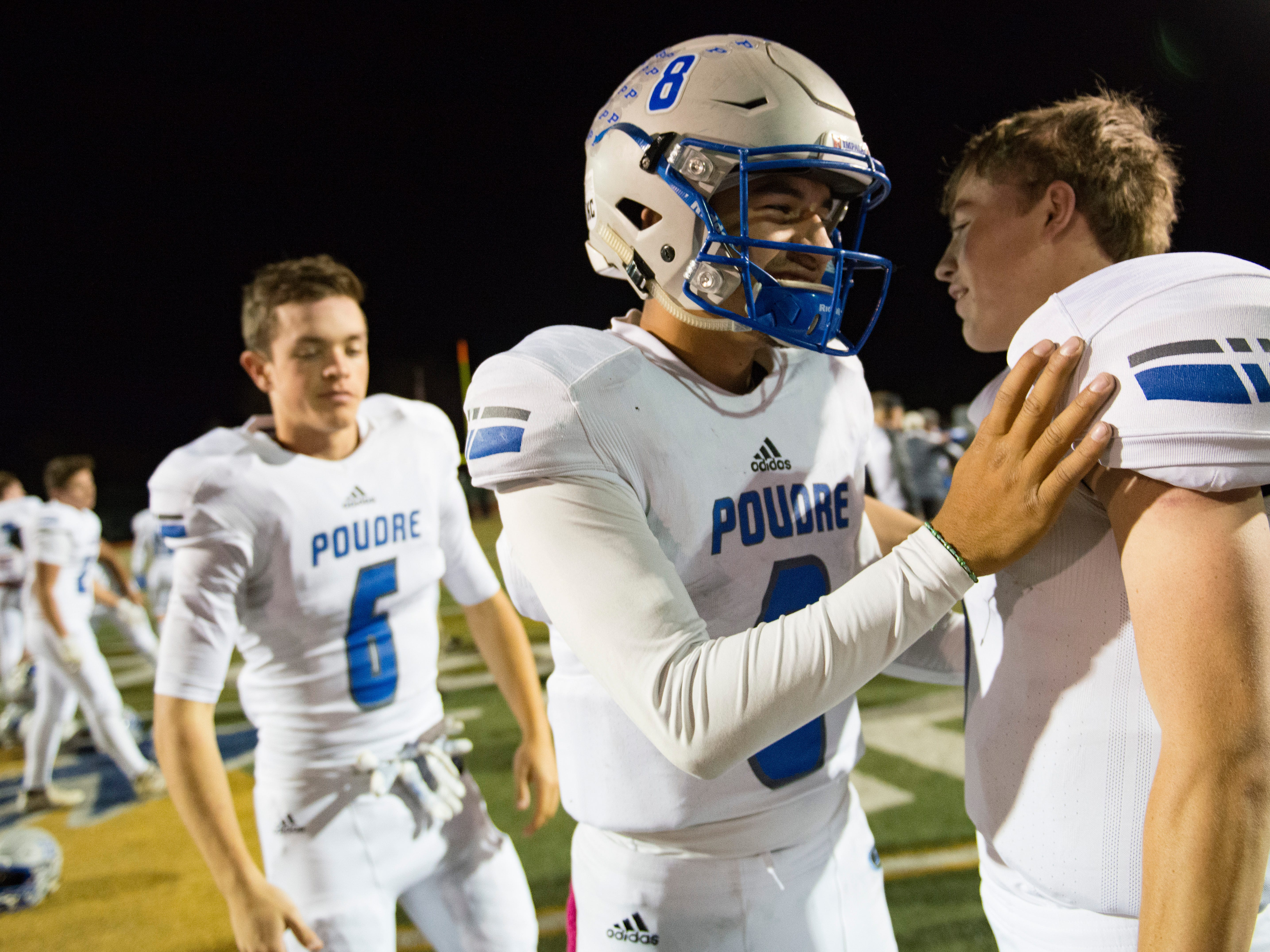 Poudre High School quarterback Sergio Tarango celebrates a 35-14 win over Fossil Ridge after a game at French Field on Friday, October 26, 2018.