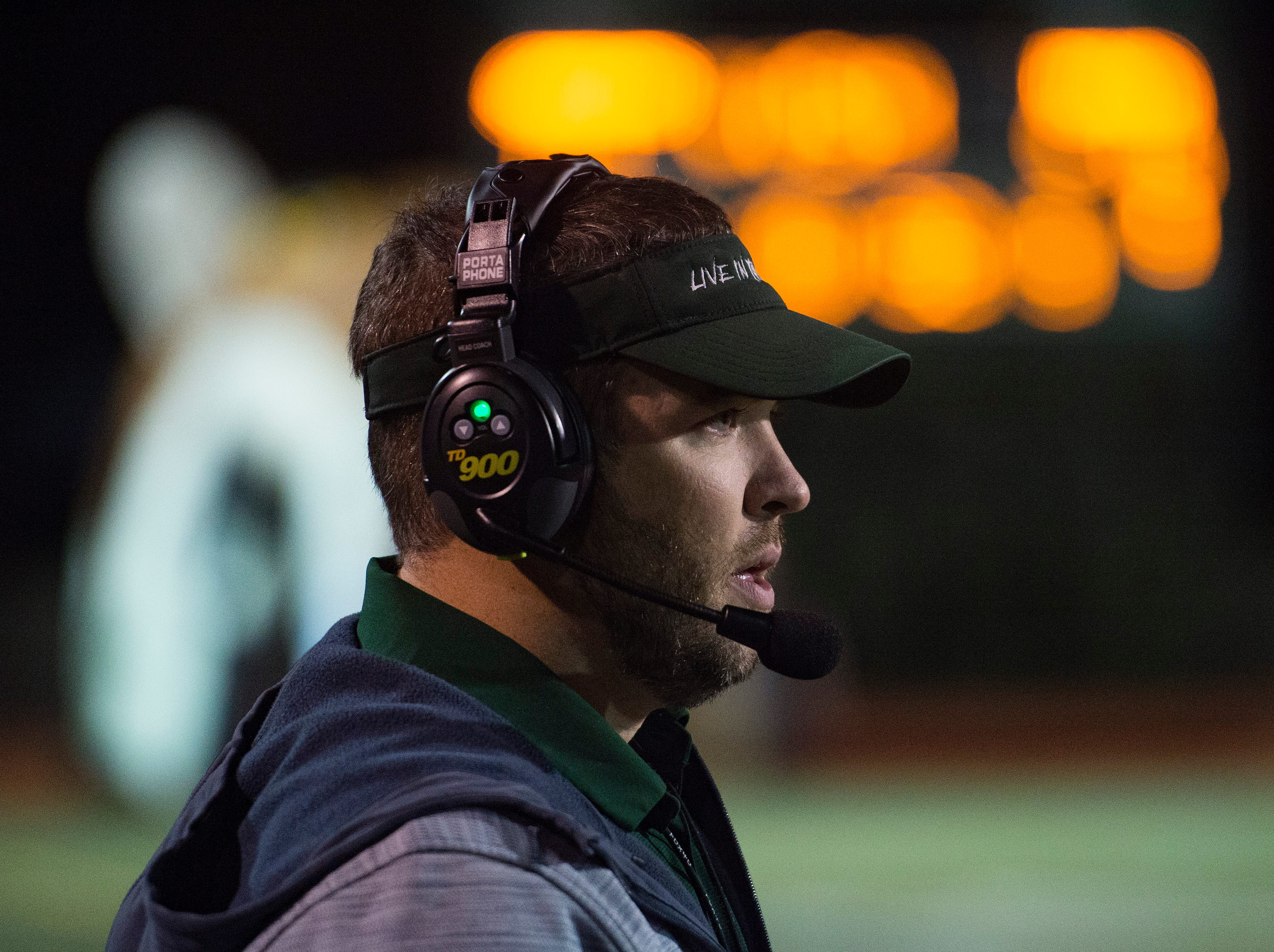 Fossil Ridge High School football coach Zak Bigelow watches the SaberCats from the sideline during a game against Poudre at French Field on Friday, October 26, 2018.