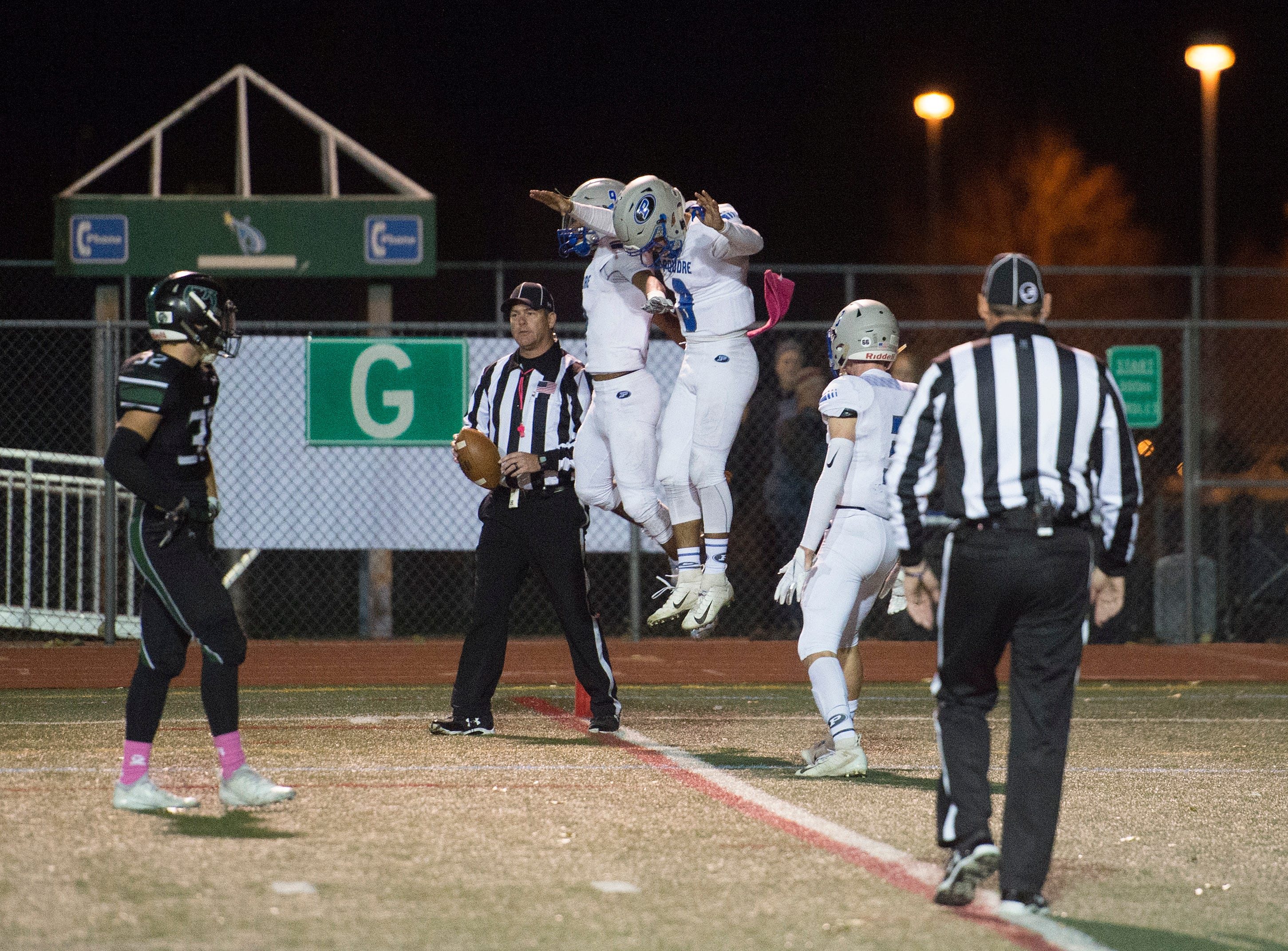 Poudre High School's Sergio Tarango and Duante Davis jump up in celebration after a touchdown from Davis in a game against Fossil Ridge at French Field on Friday, October 26, 2018.