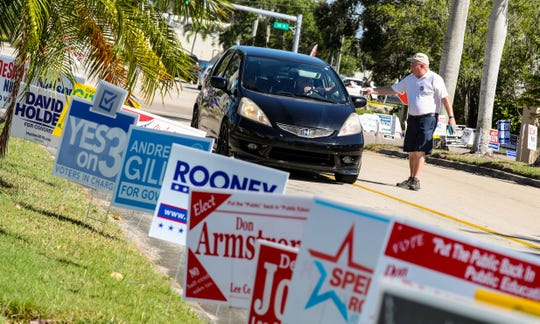 Dennis Michiels, with the Democratic Party, was handing out slate cards, that showed the democrat side of the ballot, to early voters at the Lee County Election Center. A steady stream of voters filtered into the Lee County Election Center to vote early. Many wanted to beat voting day traffic and craziness and said they found the experience to be pleasant.