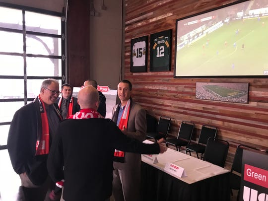 Managing Director Peter Wilt, left, and Coach Brian Kamler talk with a Green Bay soccer fan after announcing a USL League 2 team would begin play in Ashwaubenon in 2019.