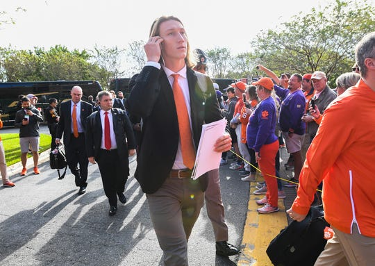 Clemson fans greet quarterback Trevor Lawrence as the teams arrives at Florida State's Doak Campbell Stadium in Tallahassee, Fl. Saturday, October 27, 2018.