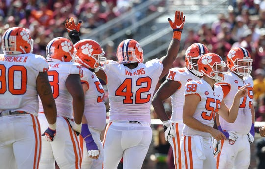 Clemson defensive lineman Christian Wilkins (42) celebrates after scoring against Florida State during the 2nd quarter Saturday, October 27, 2018 at Florida State's Doak Campbell Stadium in Tallahassee, Fl.