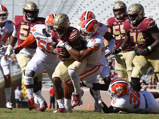 Clemson linebacker Justin Foster (35) brings down Florida State running back Cam Akers (3) during the 3rd quarter at Florida State's Doak Campbell Stadium in Tallahassee, Fl, Saturday, October 27, 2018