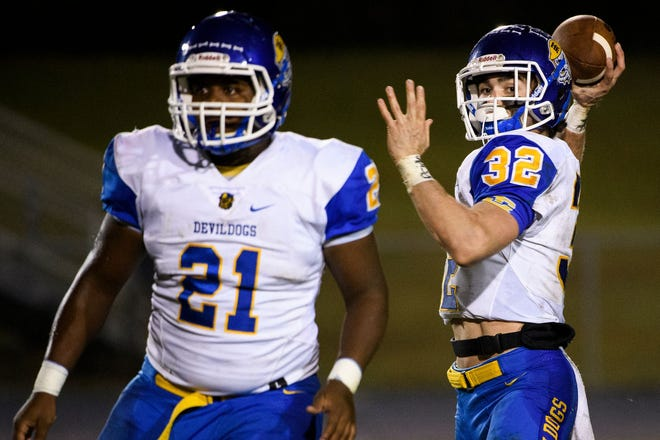 Running back Deonte Byrd (21) and quarterback Wilson Hendricks (32) have helped Travelers Rest get to seven wins for the first time in 28 years.