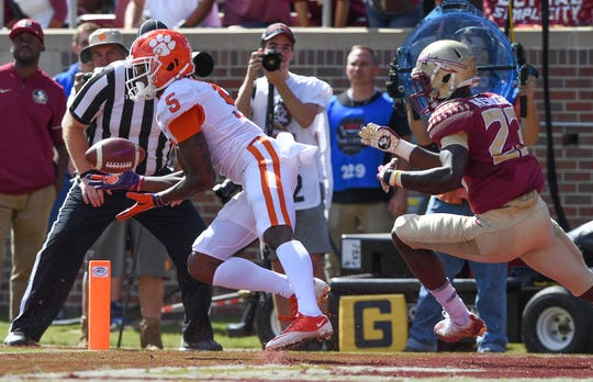 Clemson wide receiver Tee Higgins (5) catches a TD in front of Florida State defensive back Hamsah Nasirildeen (23) during the 2nd quarter Saturday, October 27, 2018 at Florida State's Doak Campbell Stadium in Tallahassee, Fl.